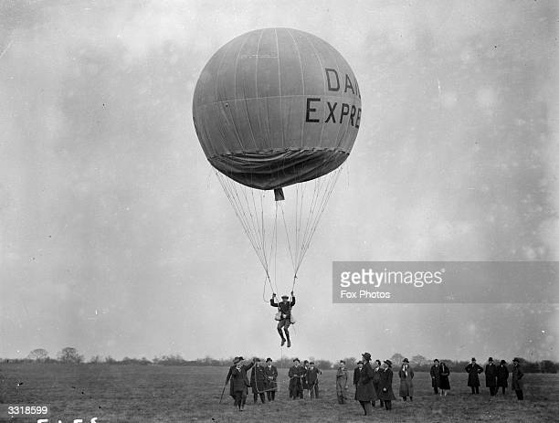 Balloon jumping at Stag Lane Aerodrome The participant is suspended in a harness under the balloon which appears to be sponsored by the Daily Express...