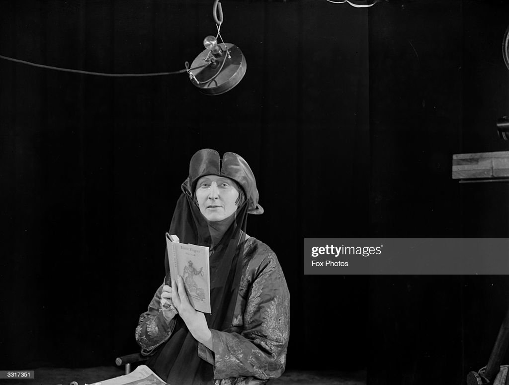 Dame Edith Sitwell (1887 - 1964), poet and author who contravened the accepted poetic style of the day and introduced different rhythms based on jazz and dance music, reading from a book at Chronofilm Studios.