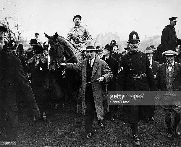 Winner of the Grand National at Aintree near Liverpool 'Sprig' being led in by owner Mrs Partridge and trainer Tom Leader The jockey is Ted Leader
