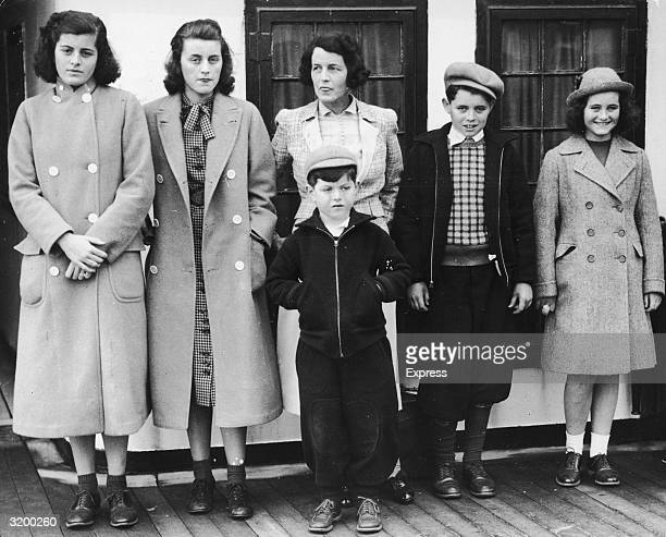 A fulllength portrait of Rose Kennedy the wife of US Ambassador to England Joseph P Kennedy and her children Kathleen Patricia Edward Robert and...