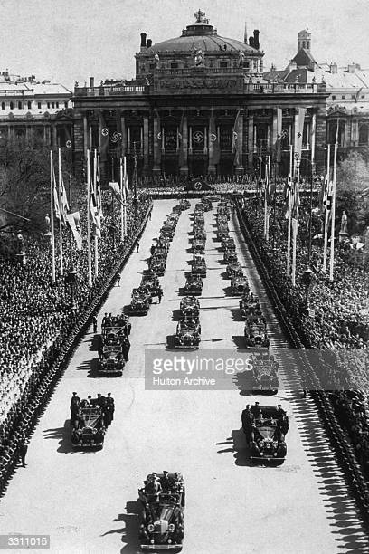 Adolf Hitler arrives in a motorcade at the 'Adolf Hitler Palace' in front of Vienna's town hall from where Dr Goebbels proclaimed a greater Germany
