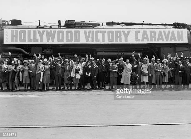 EXCLUSIVE Cast of 'Hollywood Victory Caravan' Los Angeles train station California World War II March 1942 LR Frances Gifford Jerry Colonna Karin...
