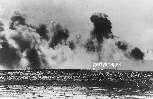 American forces advance on the horizon their way obscured by cannon fire from German JU 88's and shells from Italian batteries They fought hard to...