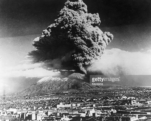A cloud of ash hangs over Vesuvius during its worst eruption in more than 70 years In the foreground is the city of Naples The nearby towns of Massa...