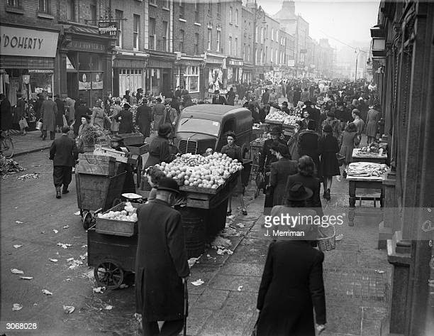 Despite rationing in post war Dublin shopping in Moore Street Market is a joy to the Irish housewife