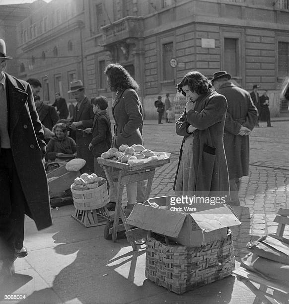 In post war Rome despite food shortages it is easy to buy bread on the black market