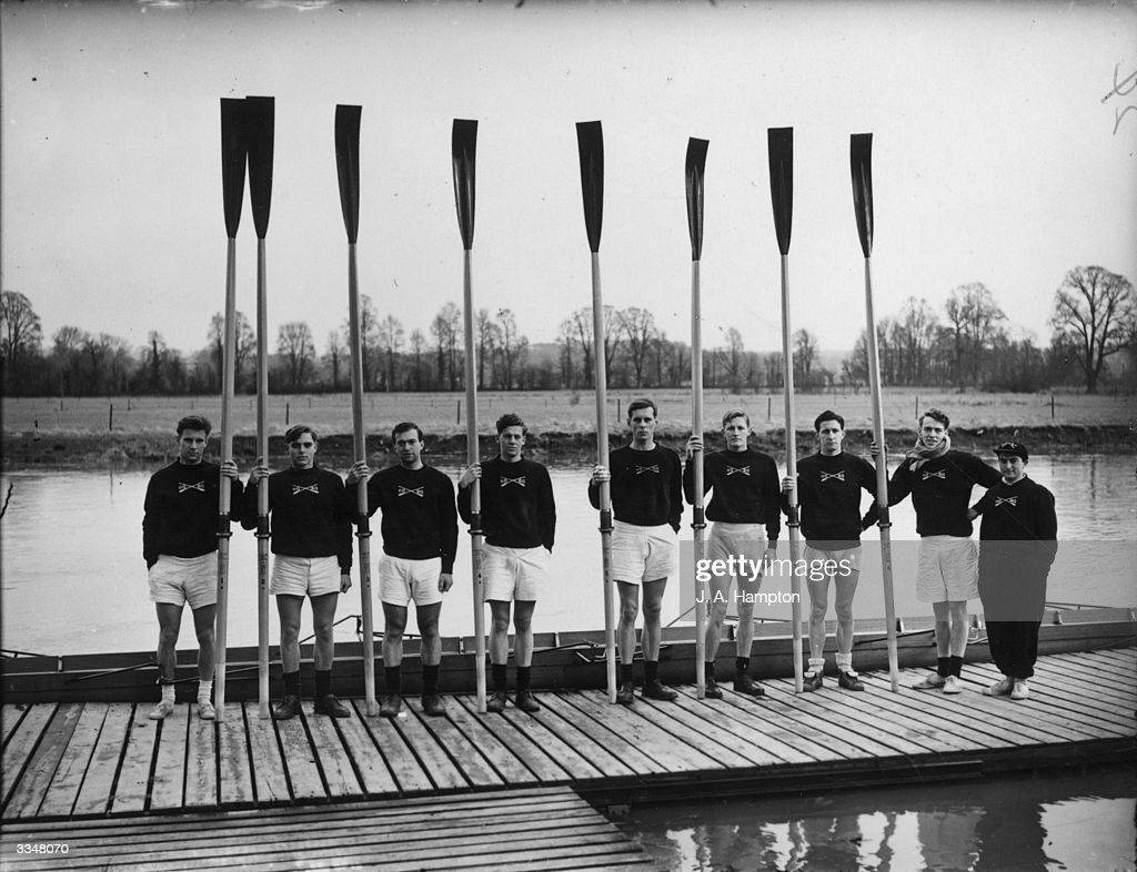 The Oxford rowing crew holding their oars aloft during training for the annual University boat race with Cambridge.