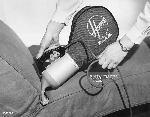 A Hoover Dustette handheld vacuum cleaner
