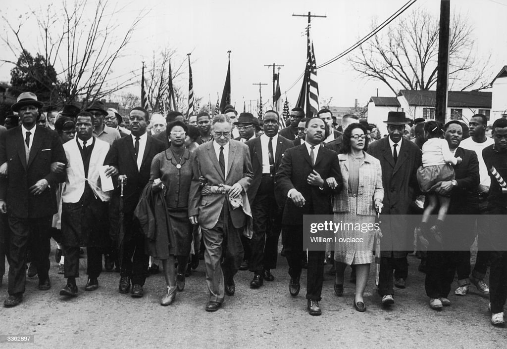 American civil rights campaigner Martin Luther King (1929 - 1968) and his wife <a gi-track='captionPersonalityLinkClicked' href=/galleries/search?phrase=Coretta+Scott+King&family=editorial&specificpeople=93252 ng-click='$event.stopPropagation()'>Coretta Scott King</a> lead a black voting rights march from Selma, Alabama, to the state capital in Montgomery.