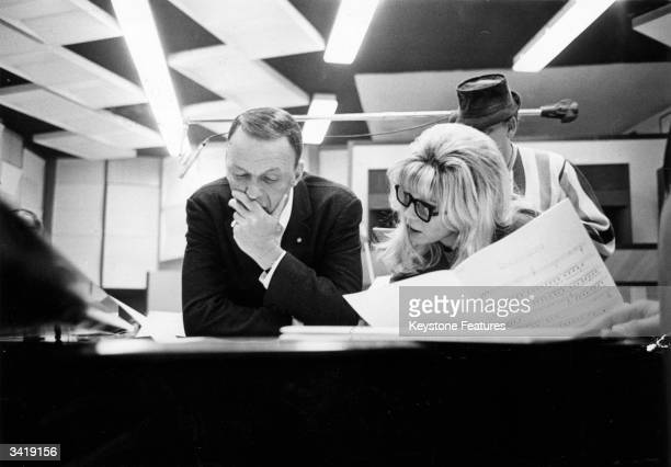 American film star and singer Frank Sinatra discusses musical interpratation with his daughter Nancy The famous father and daughter pair are in the...