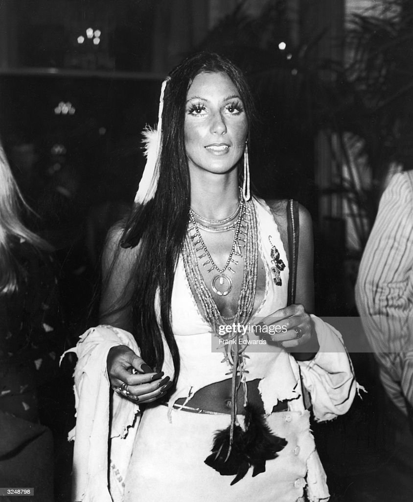 American actor and singer Cher attends a party for the premiere of the film, 'Last Tango in Paris,' directed by Bernardo Bertolucci. Cher is wearing a Native American-inspired outfit and false eyelashes.