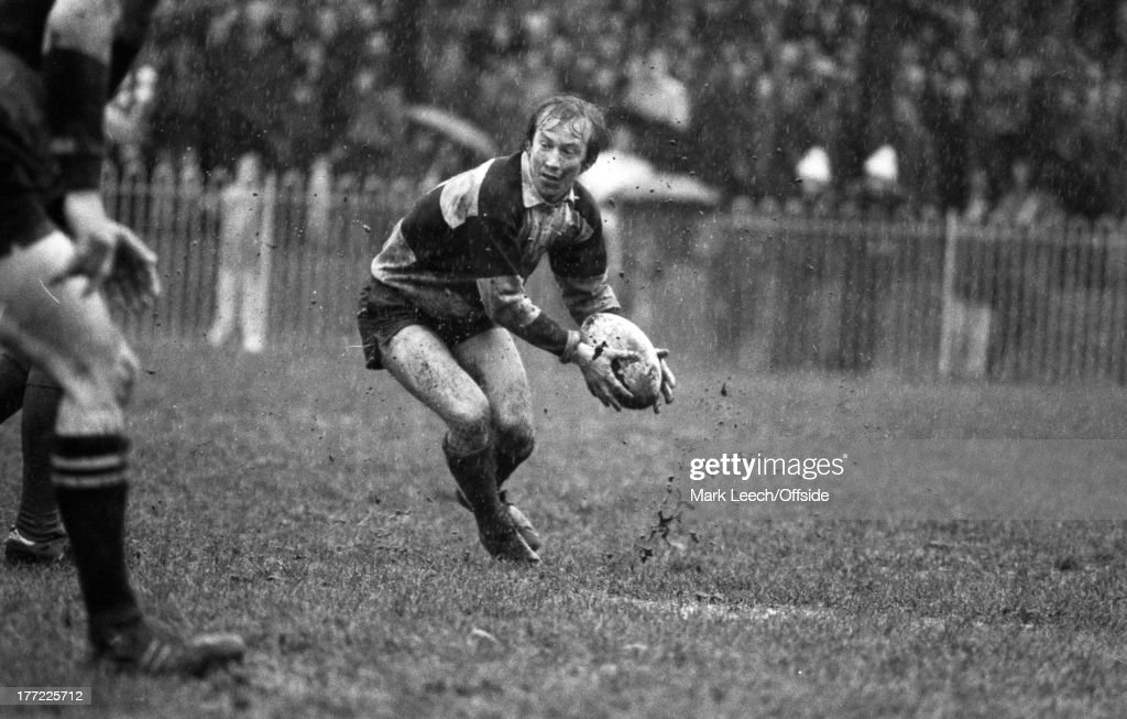 08 March 1979 Rugby Union East Midland v Barbarians Barbarian scrum half Malcolm Young picks up the ball in the wet muddy conditions