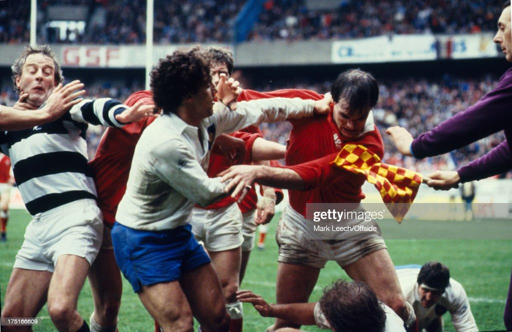 19 March 1987 Paris 5 Nations Rugby France v Wales Referee Thomas Doocey and French scrumhalf Gerard Martinez try to intervene as Terry Holmes looks...