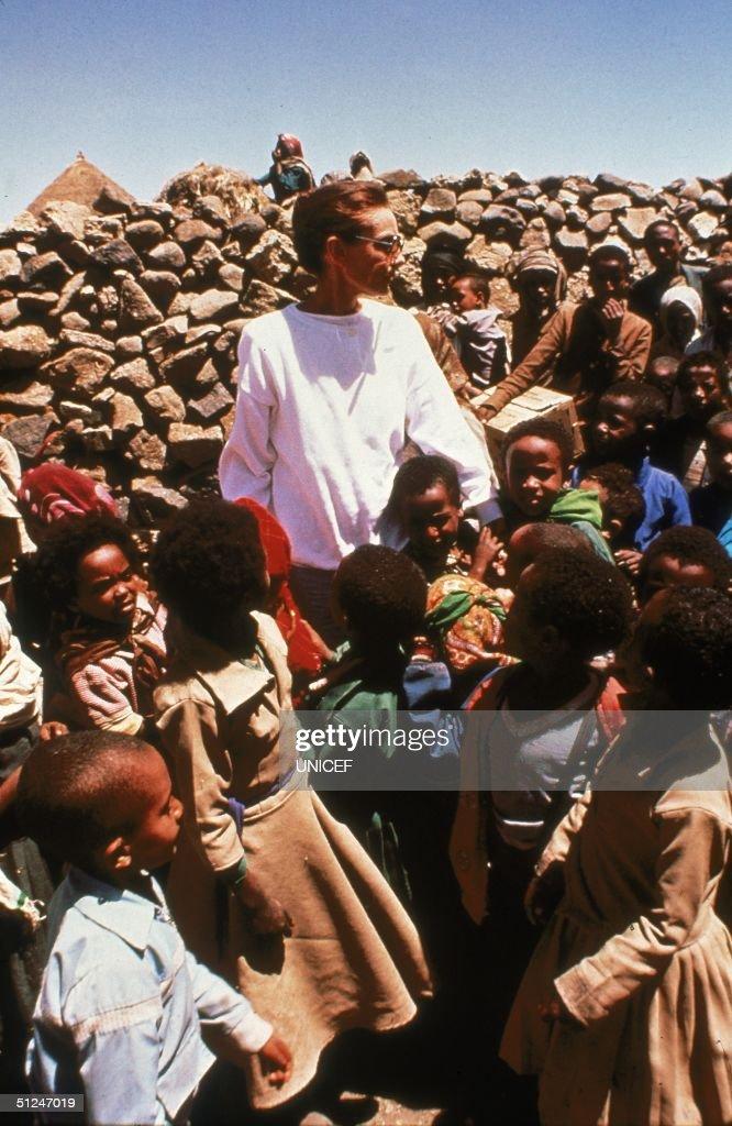 March 1988, Belgian-born actor and UNICEF Special Ambassador Audrey Hepburn (1929 - 1993) stands with children in drought-stricken Ethiopia.