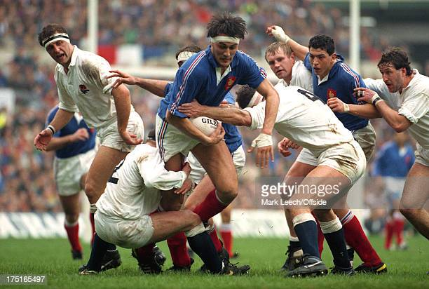16 March 1991 5 Nations Rugby England v France Olivier Roumat is tackled by Brian Moore and Paul Ackford watched by Wade Dooley Dean Richards...
