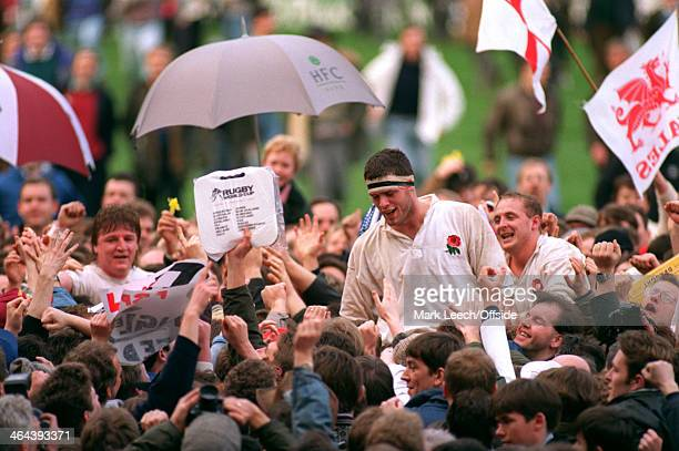 7 March 1992 5 Nations Rugby England v Wales Fabs swarm onto the pitch to celebrate with England players Martin Bayfield and Dewi Morris
