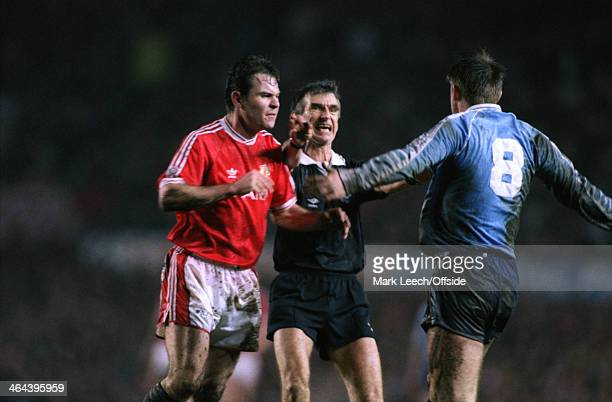 11 March 1992 Rumbelows Cup SemiFinal Manchester United v Middlesbrough The referee intervenes as Brian McClair of United squares up to Jamie Pollock...