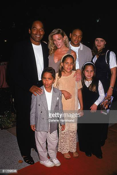 March 1994 Football player and actor O J Simpson poses with his exwife Nicole Brown Simpson and their children at the premiere of director Peter...