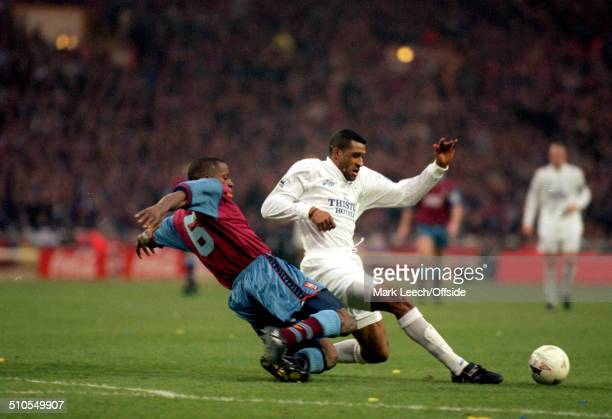 24 March 1996 Coca Cola League Cup Final Aston Villa v Leeds United Ugo Ehiogu of Villa and Brian Deane of Leeds challenge for the ball