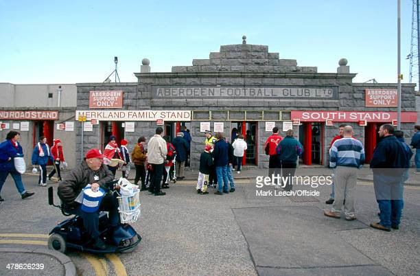 21 March 1998 Scottish Premiership Aberdeen v Celtic Fans linger outside and make their way into the Pittodrie Stadium