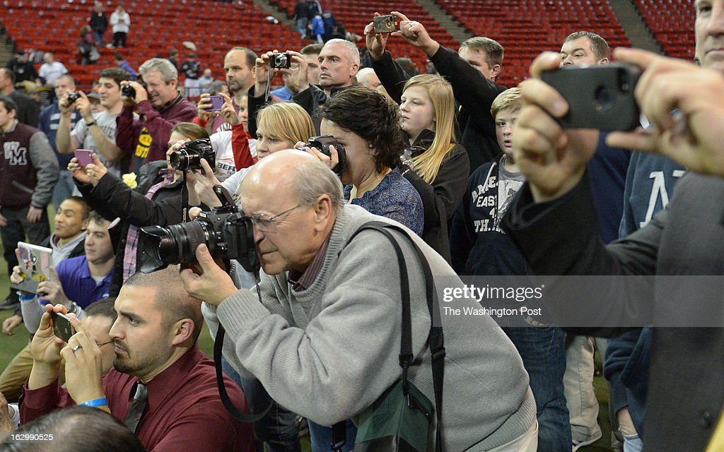 Family members and friends take snapshots of the Maryland 4A/3A winners on March 2, 2013 in College Park, MD