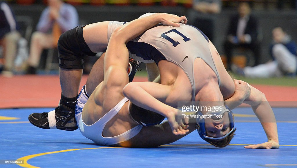 Mike Virnelson of Urbana is flipped over by Garrett Lineberger of Thomas Ston during the 182 pound title match on March 2, 2013 in College Park, MD