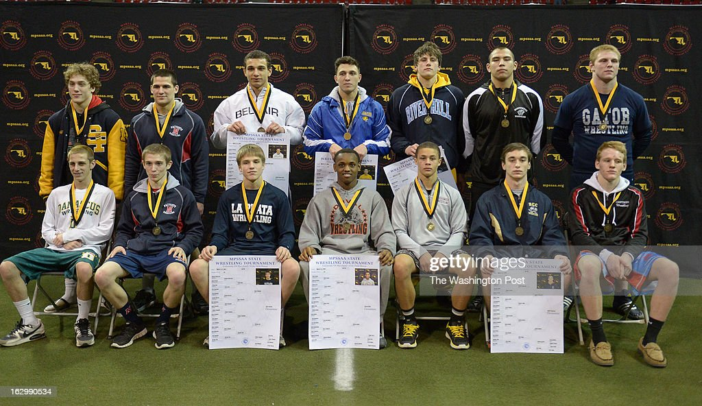 The Maryland 4A/3A State Champions pose for a group shot following the title matches on March 2, 2013 in College Park, MD