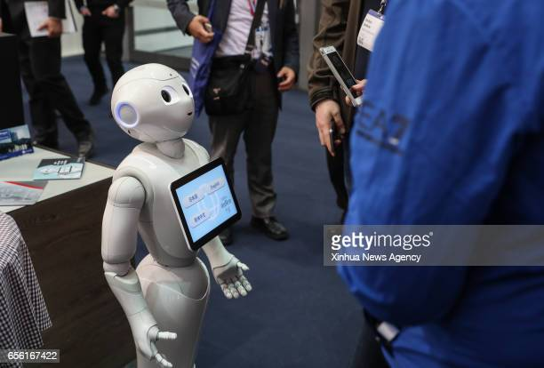 HANOVER March 20 2017 Photo taken on March 20 2017 shows a robot displayed at a booth during the CeBIT 2017 in Hanover Germany The world's leading...