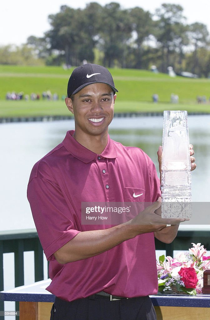 Tiger Woods poses with the 2001 Players Championship trophy at TPC at Sawgrass in Ponte Vedra Beach Florida DIGITAL IMAGE Mandatory Credit Harry...