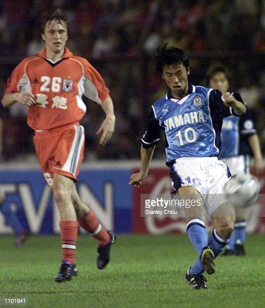 Toshiya Fujita of Jubilo Iwata Japan unleashed a shot while Nagorniak Sergei of Shandong Luneng China looks on during the Asian Club Championship...