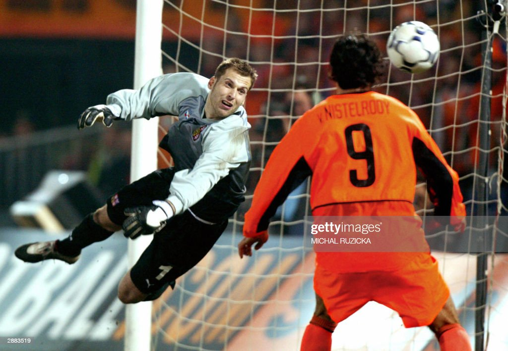 29 March 2003, Czech national team goalie, <a gi-track='captionPersonalityLinkClicked' href=/galleries/search?phrase=Petr+Cech&family=editorial&specificpeople=212890 ng-click='$event.stopPropagation()'>Petr Cech</a> tries to stop a ball fired by Dutch Ruud van Nistelrooy during a Euro 2004 Group match in Rotterdam. Chelsea have agreed to sign Czech international <a gi-track='captionPersonalityLinkClicked' href=/galleries/search?phrase=Petr+Cech&family=editorial&specificpeople=212890 ng-click='$event.stopPropagation()'>Petr Cech</a> from French first division club Rennes at the end of the season, the player's agent Zika said 19 January 2004 in Prague. The 6ft 5ins (1.96 metre) keeper will sign a five-year contract with the London club in July 2004. Zika gave no financial detail of the deal, but Czech press reports put the transfer fee at around 13 million euros (16 million dollars). Chelsea have spent 111 million pounds (191 million dollars) on players since the club owner Russian billionaire Roman Abramovich bought the club for 140 million pounds July 2003.