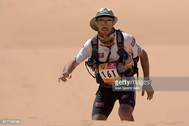 Herve Demirdjian of France climbs a dune in erg Znaigui en route to check point 3 during fifth stage of the 22nd Marathon des Sables between west of...