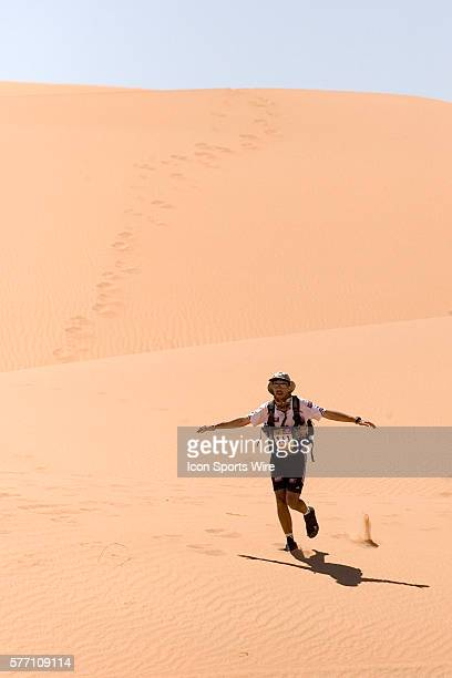 Herve Demirdjian of France runs in erg Znaigui en route to check point 3 during fifth stage of the 22nd Marathon des Sables between west of Kfiroun...