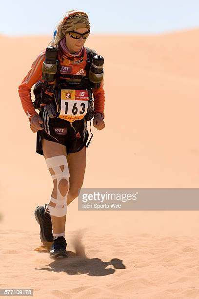 2006 winner of the women race Geraldine Courdesses of France runs over a dune in erg Znaigui en route to check point 3 during fifth stage of the 22nd...