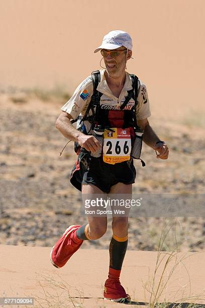 Lionel Eveno of France runs in erg Znaigui en route to check point 3 during fifth stage of the 22nd Marathon des Sables between west of Kfiroun and...