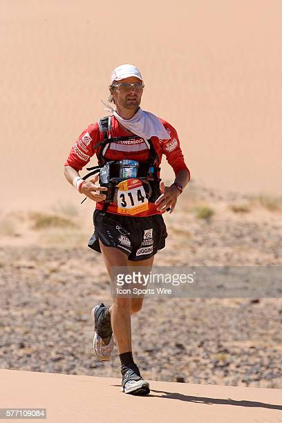 Philippe Remond of France runs in erg Znaigui en route to check point 3 during fifth stage of the 22nd Marathon des Sables between west of Kfiroun...