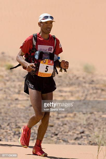 Lhoucine Akhdar of Morocco runs in erg Znaigui en route to check point 3 during fifth stage of the 22nd Marathon des Sables between west of Kfiroun...