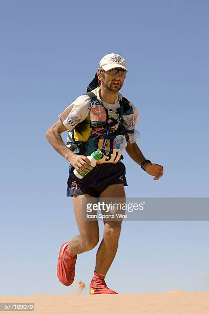 Aubeso MartineJorge runs over a dune in erg Znaigui en route to check point 3 during fifth stage of the 22nd Marathon des Sables between west of...