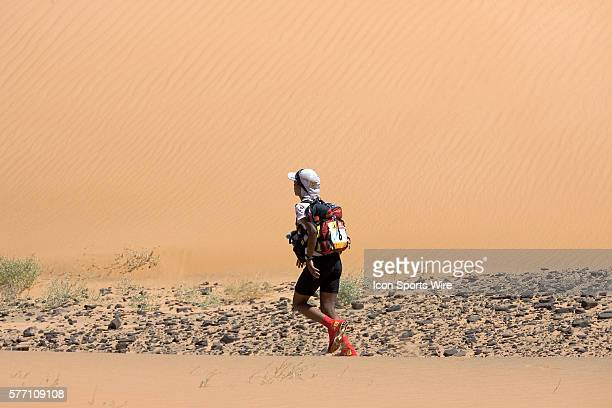 Touda Didi of Morocco runs in erg Znaigui en route to check point 3 during fifth stage of the 22nd Marathon des Sables between west of Kfiroun and...