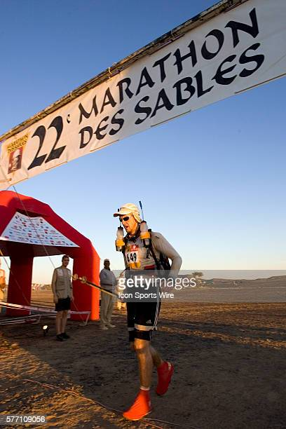 A participant crosses the finish line during fifth stage of the 22nd Marathon des Sables between west of Kfiroun and erg Chebbi The Marathon des...