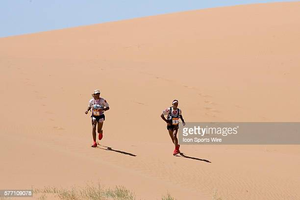 Nine times winner of the men race Lahcen Ahansal of Morocco and his brother Muhammad Ahansal of Morocco run in erg Znaigui en route to check point 3...