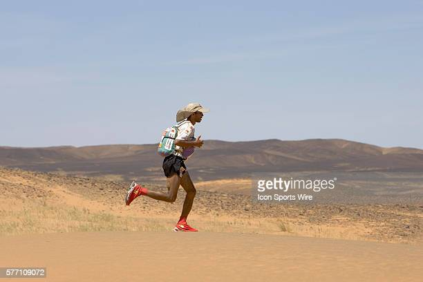 Nine times winner of the men race Lahcen Ahansal of Morocco runs across a dune in ergg Znaigui en route to check point 3 during fifth stage of the...