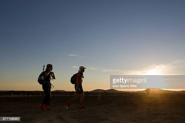 Two runners walk the last meters toward the finish line during fifth stage of the 22nd Marathon des Sables between west of Kfiroun and erg Chebbi The...