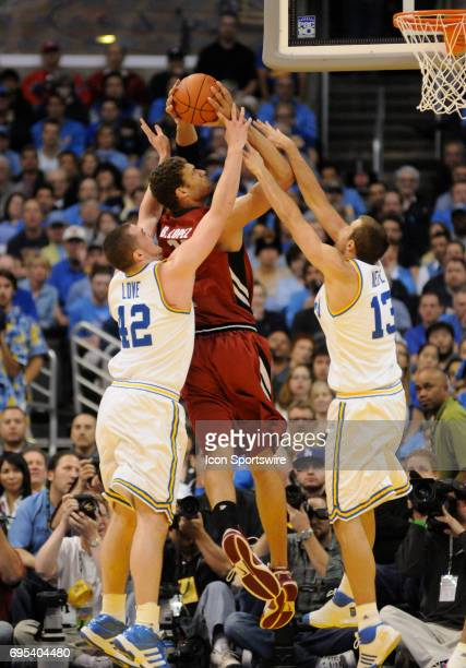 Stanford Brook Lopez shoots between UCLA Nikola Dragovic and UCLA James Keefe during the Pac10 Tournament championship game featuring the Stanford...