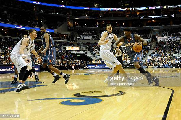Charlotte Bobcats guard Stephen Jackson in action against Washington Wizards center JaVale McGee and guard Mike Miller at the Verizon Center in...