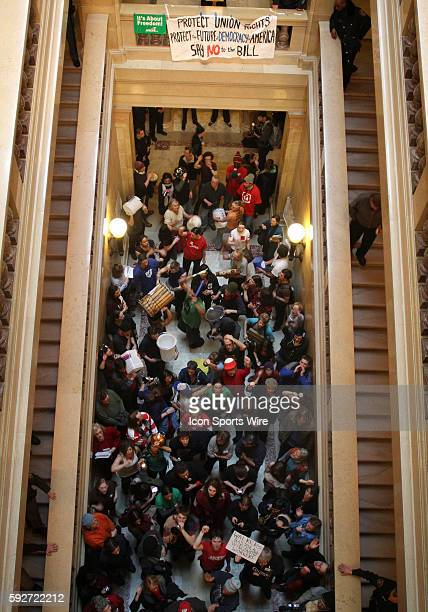 Protesters moved to a corridor on the ground floor below the Assembly Chambers in the capitol building to bang on drums and chant following Wisconsin...