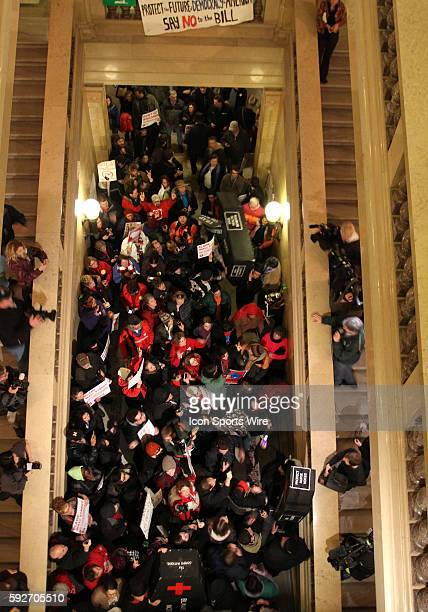 Protesters staging a mock funeral managed by means unknown to gain access the the Wisconsin State Capitol and later left along with about 100...