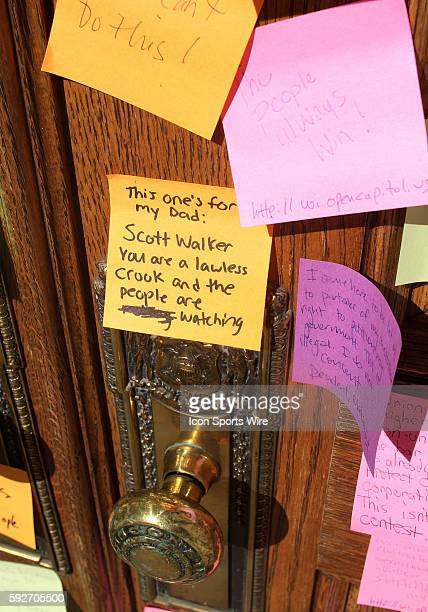 A post it note directed at Wisconsin Governor Scott Walker is posted on the staff entrance door to state capitol in protest of Walker's budget repair...