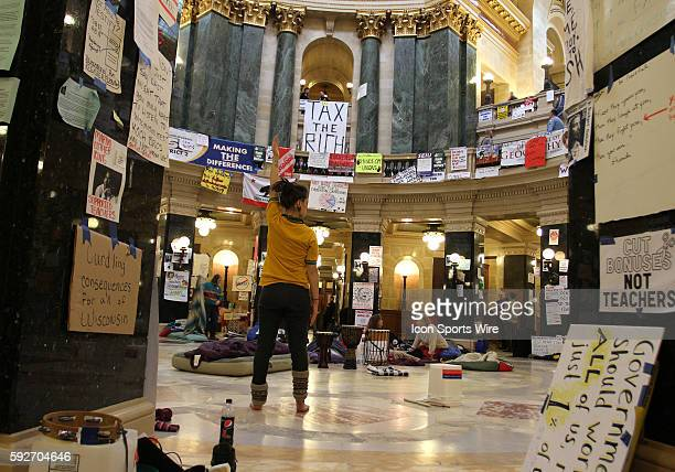 Protester Katie Kloth from Stevens Point Wisconsin begins stretching exercises the state capitol rotunda floor on the 17th day protesting Wisconsin...