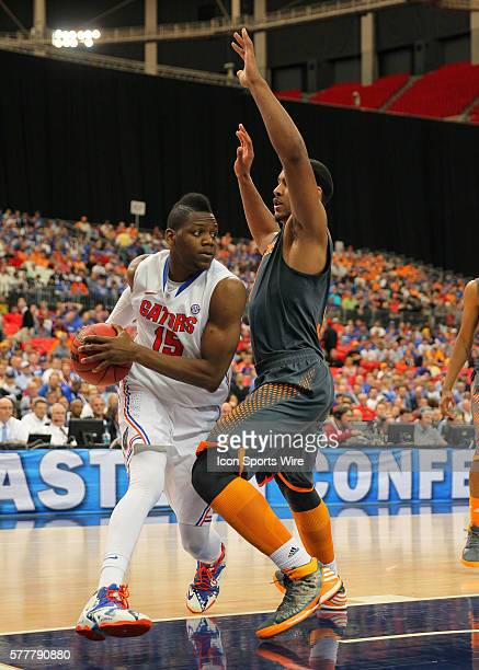 Florida Gators forward Will Yeguete drives to the basket in the Florida Gators 5649 victory over the Tennessee Volunteers in the SEC Tournament at...